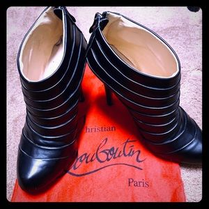 Used Louboutin black ribbed booties. Size 37